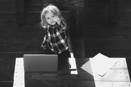 child, small business boy with phone and computer in office Stockfoto
