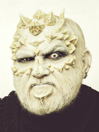 man or monster with thorns on face with futuristic makeup Stock Photo