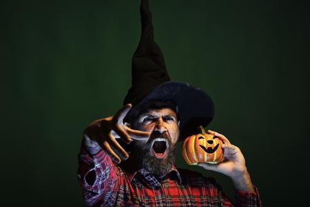 Halloween hipster with beard and jack o lantern
