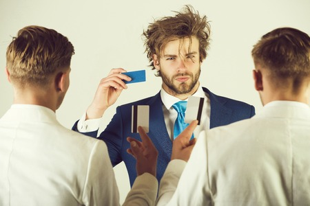 Group of people facing each other Stock Photo