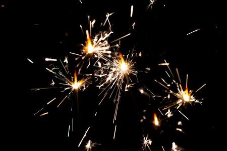 Bengal lights. Celebration Sparkler. Christmas bengal lights . Beautiful, magic story. Festive gold bokeh. Winter holidays theme. Bright bengal lights sparkles. Happy New Year.