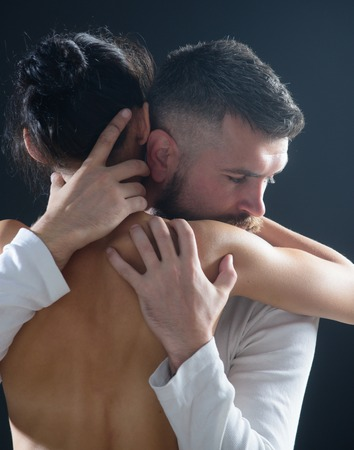 Embrace concept. Couple In Love embrace. Romantic and love. Intimate relationship and sexual relations. Closeup embrace. Passion and sensual touch. Stock Photo