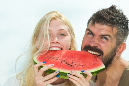 Healthy couple. Enjoying eating cooking together. Beautiful healthy young couple with healthy food. Watermelon and summer. Healthy couple eating Watermelon.