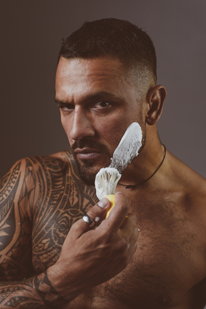Shaving gel or shaving cream. Hair Preparation is just for the dashing chap. Bearded client visiting barber shop. Protection after shaving.