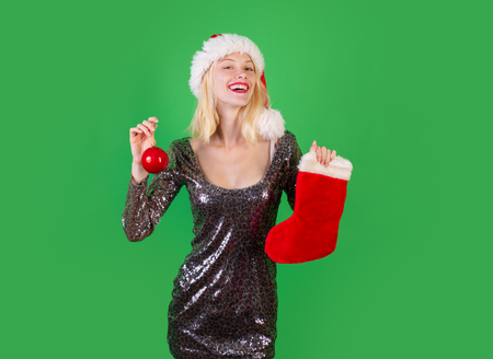 Happy woman christmas. Christmas stockings. Glamour celebration and Christmas woman dress. Merry christmas and Happy new year. New year gift. Stock Photo