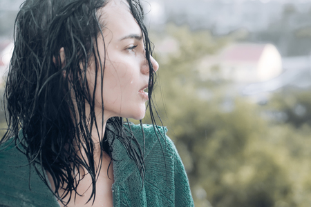 Woman in rain. Picture emotion woman. Sad female mood. Woman emotions. Cry. Stock Photo