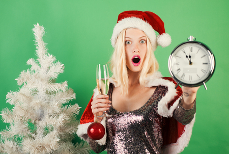 Christmas clock and time christmas. Glamour celebration and Christmas woman dress. Merry christmas and Happy new year. New year gift. Stock Photo