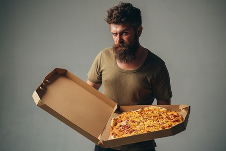 Sexy man with pizza box. Gay with Pizza. Pizza delivery concept. Italian pizzeria. Recipe pizza.