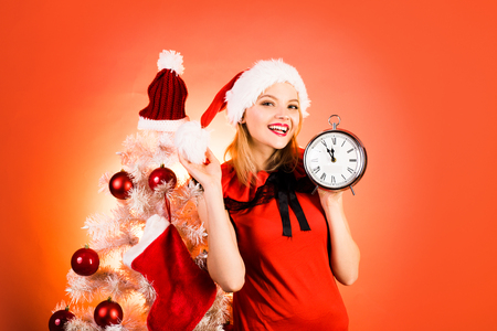 New Year clock and time christmas. Glamour celebration and Christmas woman dress. Merry christmas and Happy new year. New year gift.