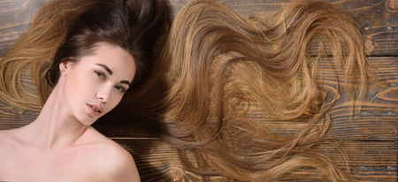 Long healthy hair. Beauty girl with long hair. Beauty hair Salon. Fashion haircut. Trendy haircuts.