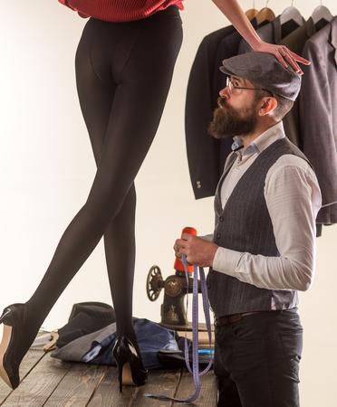 Woman legs and tailor. Fashion season. Tailor shop boutique. Womens boutique. Fashion post, magazine.