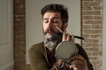 Bearded man - home beard style. Portrait of stylish man beard. Barber straight razor, barbershop. Vintage barber shop, shaving. Portrait of shaven man.