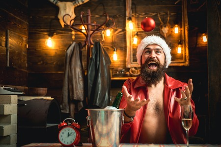 Modern hipster santa with red dress. Wish you merry christmas. Christmas santa claus. Christmas alone at home.