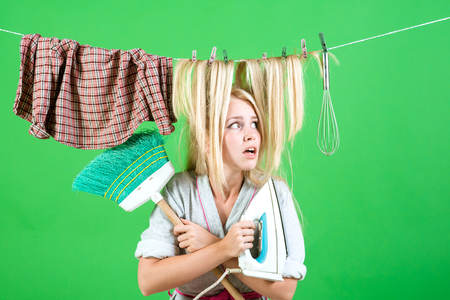 Maid or housewife cares about house. Multitasking mom. Performing Different Household Duties. Vintage housekeeper woman. emotional retro housewife. Busy mother. Not fleck of dust Фото со стока - 112477976