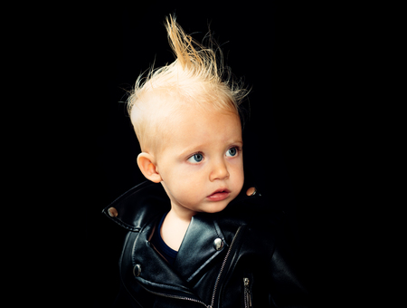 Music for children. Little rock star. Little child boy in rocker jacket. Rock style child. Rock and roll fashion trend. Adorable small music fan. Rock forever Banque d'images - 112478020