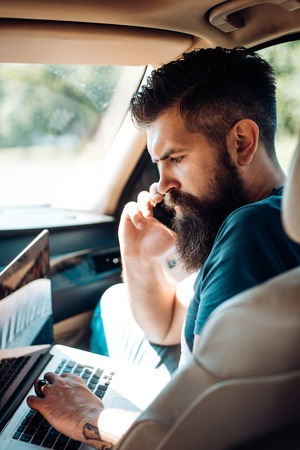 Mature hipster with beard. Male barber care. Bearded man. brutal caucasian hipster with moustache. Taxi. traffic jam on road. time. gas station. Portrait of brutal handsome male model
