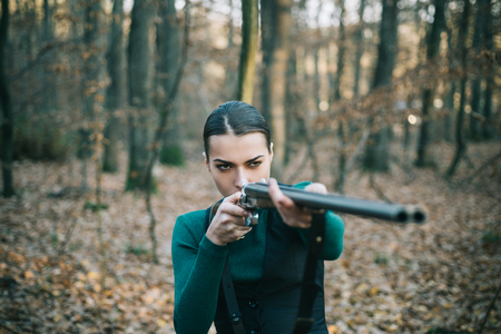 Hunter woman with shotgun on hunt. Hunting in forest. Portrait of woman Hunter. Closed and open hunting season. Autumn hunting season. Hunting.