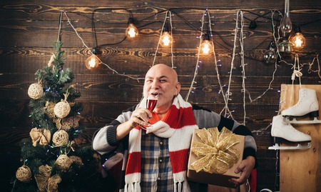 Christmas santa claus. Man smile christmas drinking champagne. Merry christmas and Happy new year.