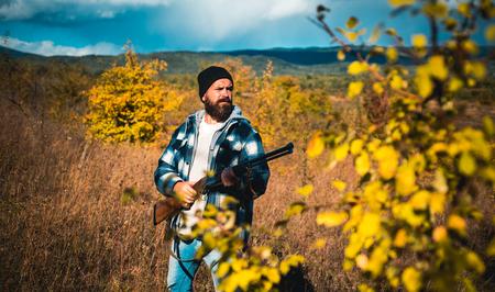 Hunter with shotgun gun on hunt. Wildlife Hunting. Reklamní fotografie - 112732272