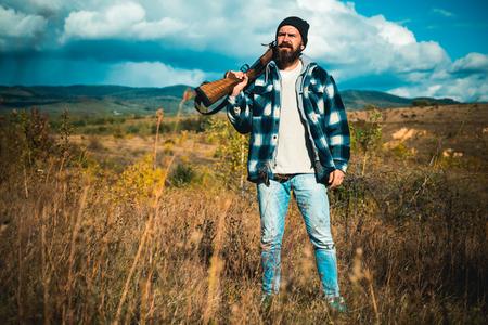 Hunter with shotgun gun on hunt. Closed and open hunting season. Deer hunt. Stock Photo