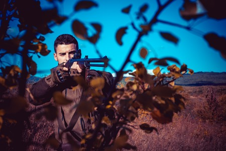 Hunter with shotgun gun on hunt. Process of duck hunting. Stock Photo