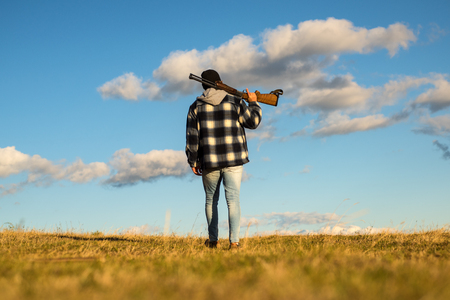 Hunter with shotgun gun on hunt. Closed and open hunting season. Stock Photo