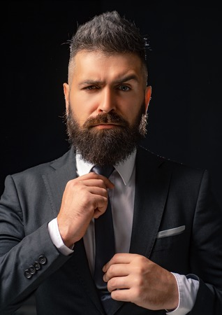Classic costume and trend. Rich bearded man dressed in classic suits. Elegance casual dress. Fashion suit. Luxury mens clothing. Man in suit. Businessman confidence. Classical costume. Mans Fashion. Stockfoto