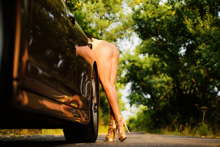 Car repair. Car conked out on the way. Motor suddenly conked out. Luxury woman and broken car. Sport car service.
