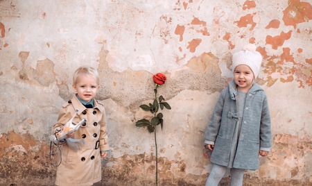 Little couple. Boy and girl shy on date. Little girl and boy together. Love, friendship concept. Valentines day. Stock Photo