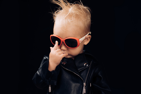 Born to be rock and roll star. Adorable small music fan. Little child boy in rocker jacket and sunglasses. Little rock star. Rock style child. Rock and roll fashion trend. Music for children