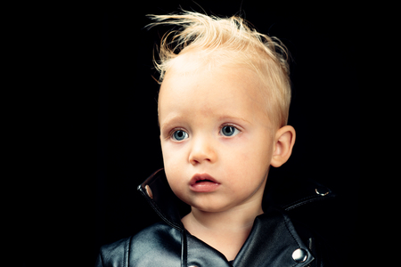 Rock style child. Rock and roll fashion trend. Adorable small music fan. Music for children. Little rock star. Little child boy in rocker jacket. Born to be punk Banque d'images - 112732681