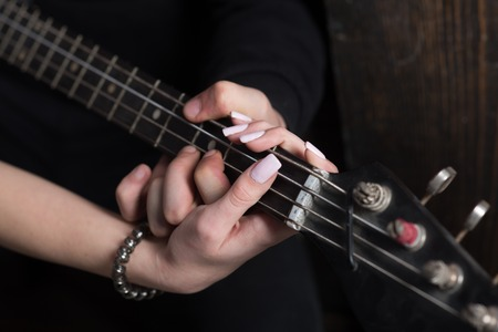 Instrumental music live. Couple in love play duets. Male and female hands play the electric guitar. Couple of guitar players. Couple of musicians enjoy playing music. Talent and virtuosity