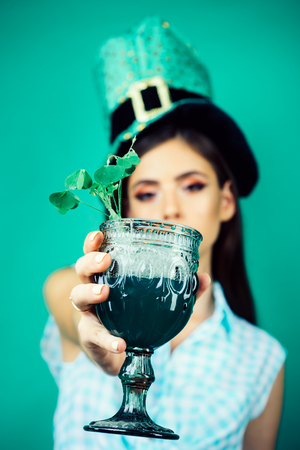 St. Patricks Day pinup girl with fashion hair. pretty girl in vintage style. pin up woman with trendy makeup. retro woman drink summer cocktail. this is for you