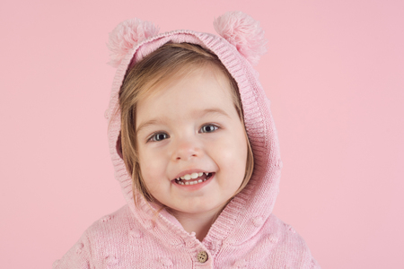 autumn and spring kid fashion. childhood and happiness. little girl child smiling. having fun. small happy girl. portrait of smiling little girl. soft and pink Archivio Fotografico - 113644610
