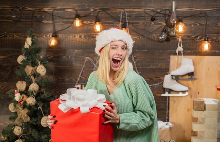 Crazy comical face. Comic grimace. Positive human emotions facial expressions. Smiling woman decorating Christmas tree at home. Having fun. Surprise concept. Expressions face. Banco de Imagens
