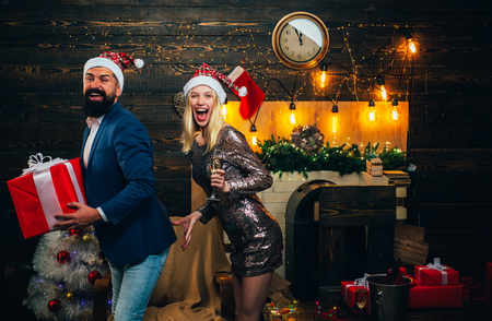 Modern Christmas Trends. Make funny face. Family happiness concept. Winter trends and season fashion. Christmas couple in love. Winter holidays and people concept.