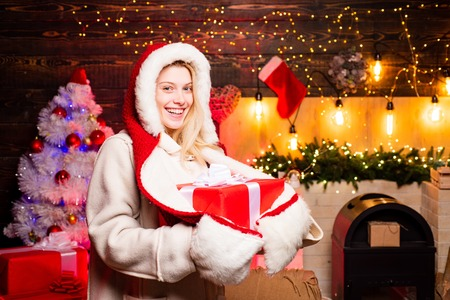 Fashion portrait of model girl indoors with Christmas tree. Sensual young girl. Christmas fashion. Seasonal Christmas holidays sale discounts. Christmas preparation. Stock Photo - 113645010