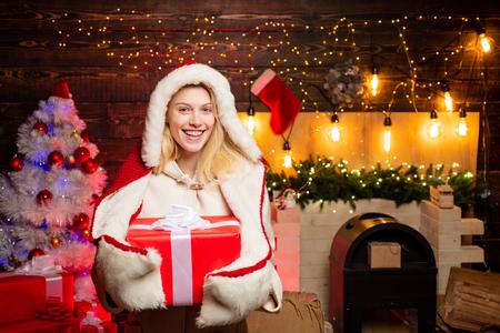 Christmas woman dress. Pretty girl wearing in Christmas dress. Beautiful Santa Clause woman. Sexy Santa Clause woman in elegant dress. Christmas gift.