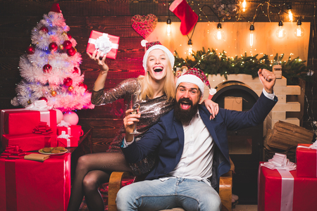 Christmas time for happy friends. Drunk Girls celebrate New Year. Woman and handsome man with Santa dress.