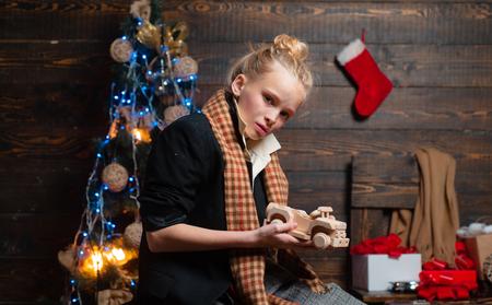 Christmas teenager homeless. Christmas unhappy children. Merry Christmas for dirty Little girl with Christmas gift box