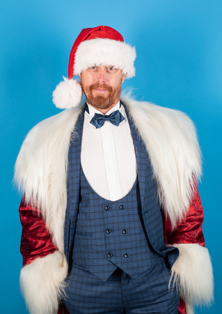 Fashion santa. Santa claus with Christmas suit. Christmas eve. Happy new year. Stock Photo