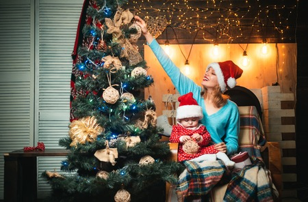 Child with mom. Christmas present gift. Cute little kids celebrating Christmas. kiddy. Happy child with christmas gift.