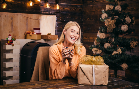 New years eve girl. Winter woman wearing red santa claus hat. Young woman wink. Expressions face. Crazy comical face. Funny Laughing Surprised Woman Portrait. Stock Photo