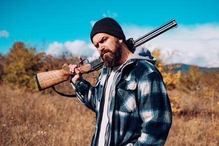 Hunter with shotgun gun on hunt. Gun rifle.