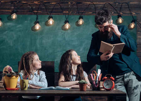 Children must be taught how to think not what to think. Children need private coach to keep up with the class. Education at the elementary school - pupil writing in notepad at his desk happy