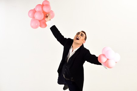 I was born to party. Holding festive celebration. Mime man with party balloons. Man with mime makeup on birthday party. Balloon artist. Happy birthday or anniversary celebration. Imagens