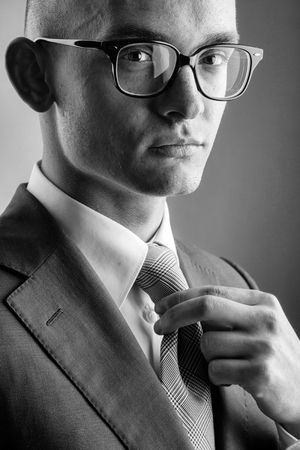 Fashionable young guy in glasses