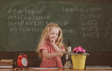 Small girl hold finger on lips keeping big secret in school. She got a secret, vintage filter. 스톡 콘텐츠 - 118688139