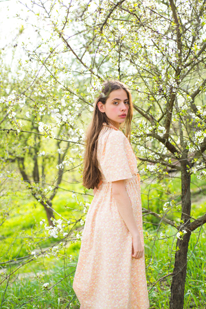 Spring style. Summer girl with long hair. Spring woman. Springtime and vacation. Natural beauty and spa therapy. Woman with fashion makeup. face and skincare. Travel in summer. blossom.