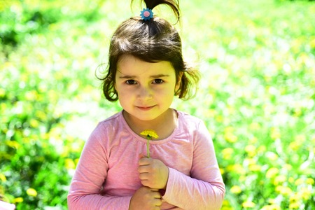 Spring holidays. Springtime. weather forecast. Little girl in sunny spring. face and skincare. allergy to flowers. Summer girl fashion. Happy childhood. Small child. Natural beauty. Childrens day. Stock Photo